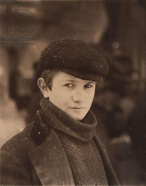 Portrait of Young Newsboy during Light Snowfall, Utica, New York, USA, circa 1910