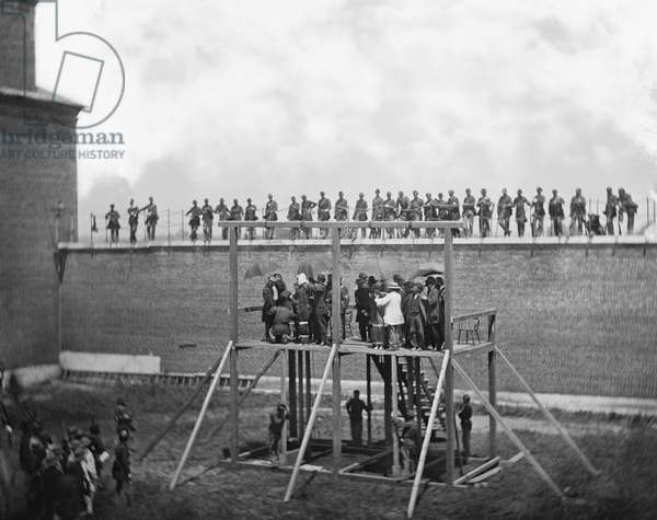 Adjusting Ropes on Scaffold of Conspirators of Assassination of U.S. President, Abraham Lincoln, Arsenal Prison, Washington, DC, USA, by Alexander Gardner, July 7, 1865 1865 (b/w photo)
