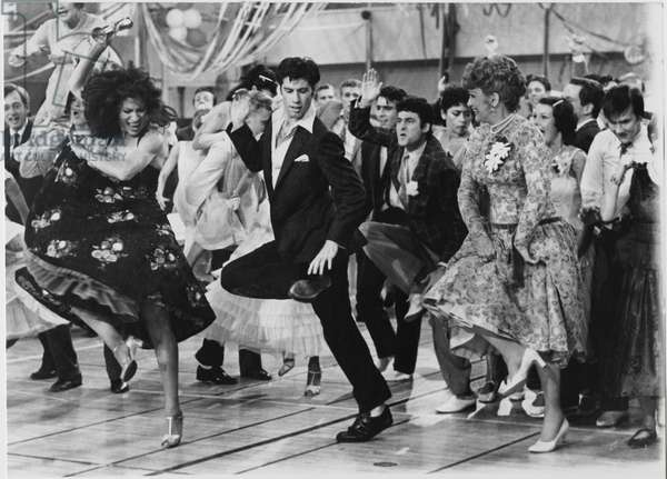"John Travolta, Eve Arden and Cast on-set of the Film, ""Grease"", 1978 (b/w photo)"