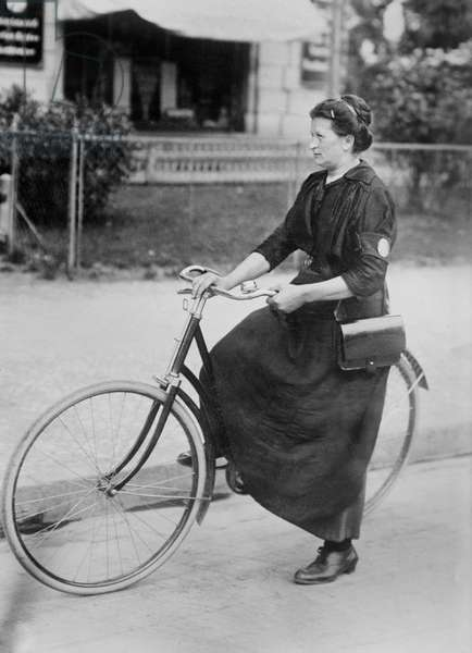 Female Telegraph Messenger on Bicycle during World War I, Berlin, Germany, Bain News Service, 1915 (b/w photo)
