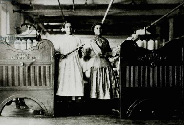 Two young girl workers in a mill, 1910 (b/w photo)