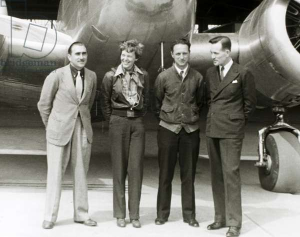 Amelia Earhart Standing With Paul Maas, Harry Manning and Fred Noonan in Front of her Lockheed Electra Airplane, Honolulu Airport, Hawaii, March 20, 1937