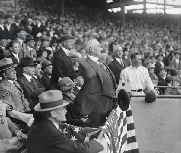 U.S. President Warren Harding throwing out First Ball, Griffith Stadium, Washington DC, USA, 1923 (b/w photo)