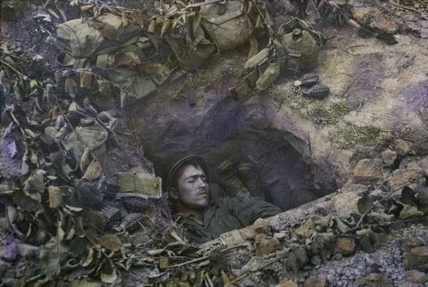 Two U.S. Infantrymen Share a Foxhole near Frontlines after the Allied Invasion of Normandy, Near Bayeux, Calvados, France, July 1944 (photo)