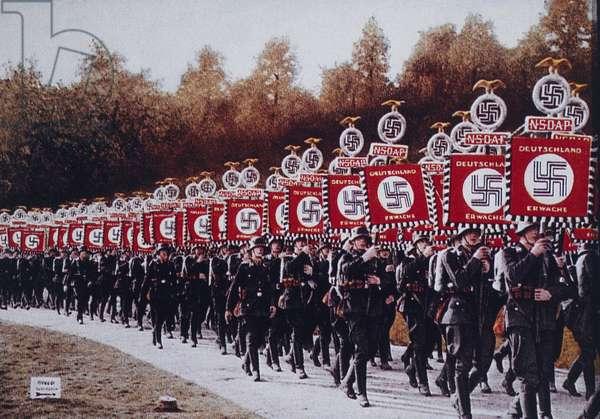 German SS Troops Bearing Standards March in Zeppelin Field, Nurnberg, Germany, 1933