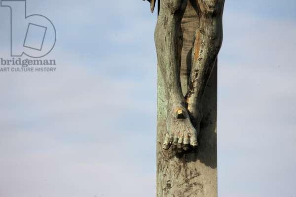 Statue of Jesus on the cross on Charles bridge ; Prague Czech Republic