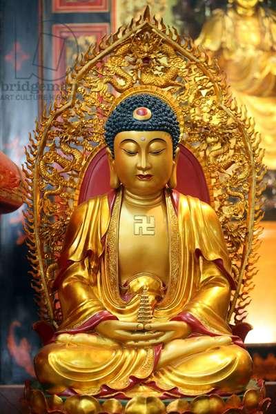 Leong San buddhist temple. Golden Buddha statue. Singapore