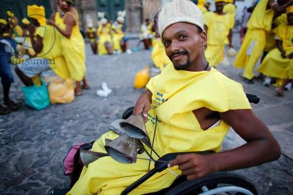 Brazil, Bahia, Salvador : Disabled man participating in the Salvador carnival in Pelourinh