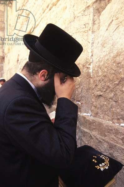 Orthodox Jew praying at the Western wall, Jerusalem, Israel