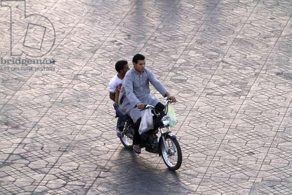 Moroccan boys on a motorcycle, Marrakech, Morocco