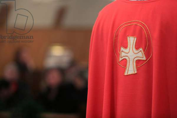Embroidered cross on a red chasuble, Villemomble, France