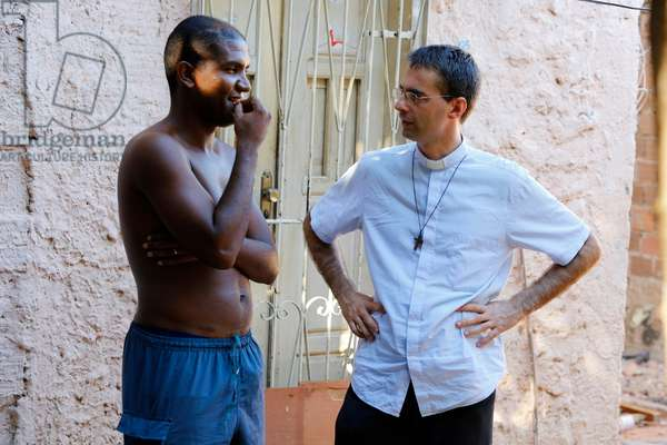 Brazil, Bahia, Salvador : French priest Etienne Kern with a parishioner in Alagados favel