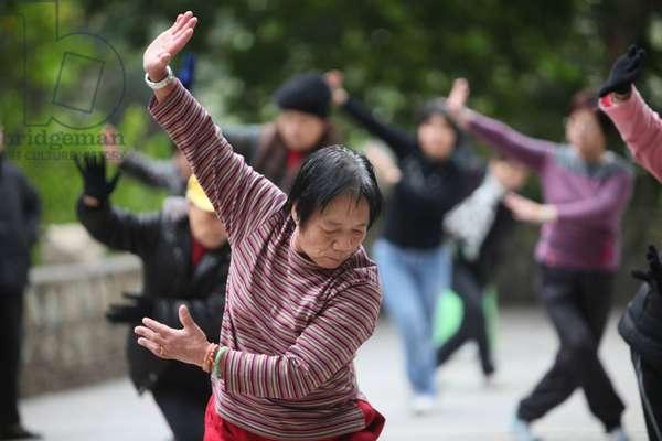 Morning tai-chi exercises in a park. Macau China