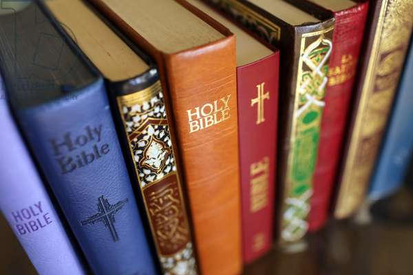 Stack of holy books : Bible and Quran. Christianity and Islam.