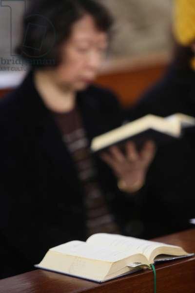 Woman reading the bible. Macau China