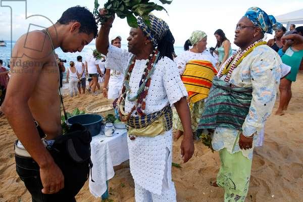 Brazil, Bahia, Salvador : CandomblŽ priest performing a ritual during Iemanja festival in Rio Vermelh