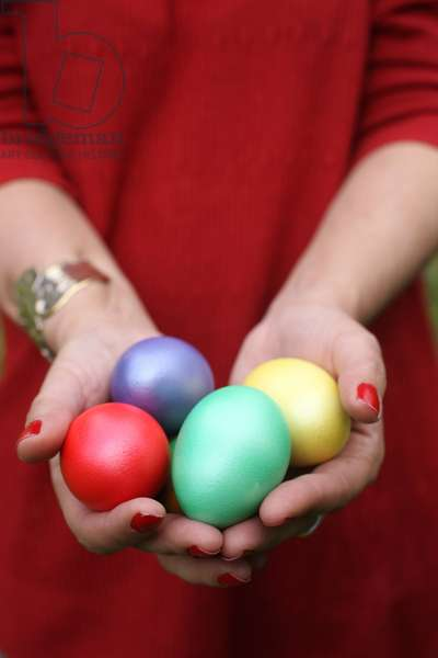 Easter eggs in hands. Saint-Gervais France
