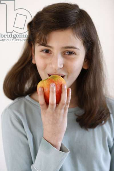 10-year-old girl eating an apple, Montrouge, France