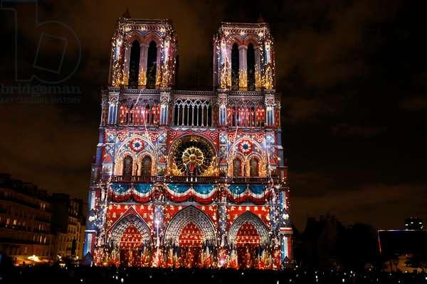 Sound and light show at Notre Dame de Paris cathedral, France (photo)