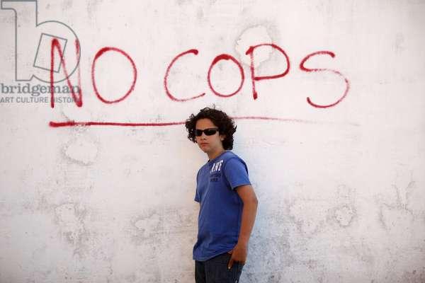 Teenage boy standing in front of graffiti, Otranto, Italie