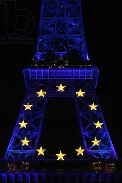 Eiffel tower lit up with European logo, Paris, France