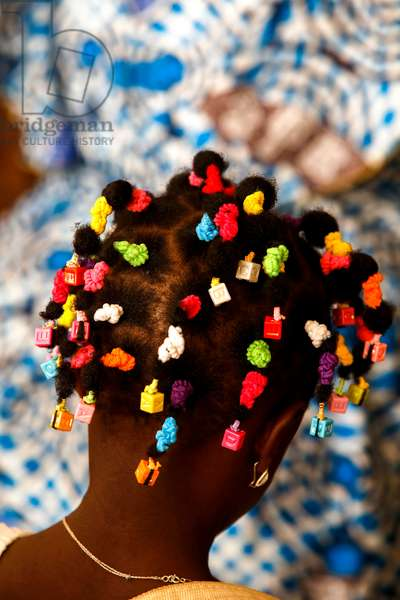 Girl with a fancy hairstyle in Cristo Risorto de Hedzranawoe catholic parish church, Togo, 2017 (photo)