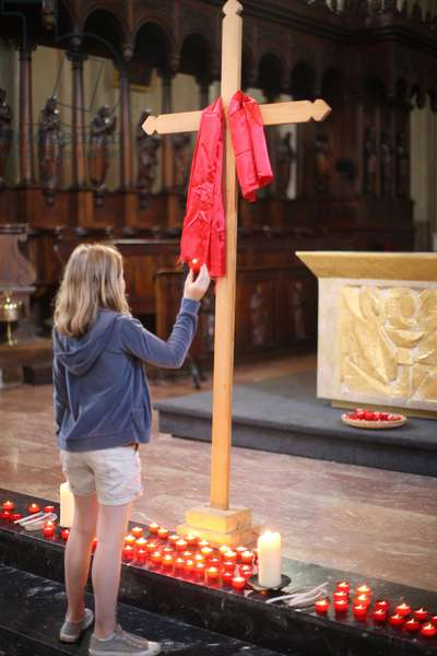 Red fabric on cross on Good Friday. Sallanches France