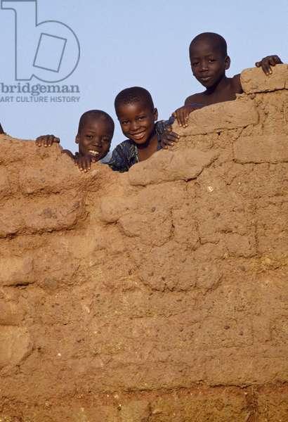 African children playing on a wall, Bamako, Mali