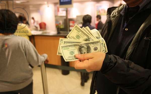 Man holding US dollars. Hong Kong China