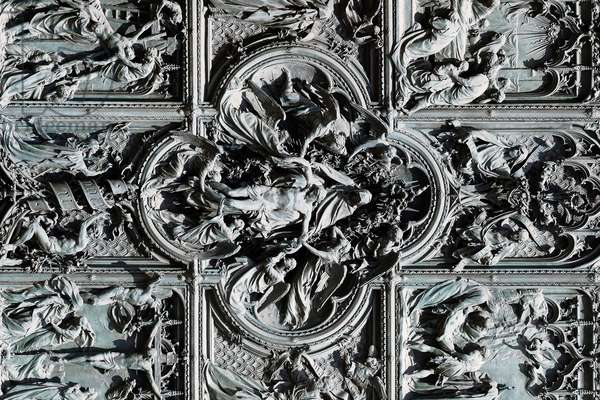 Milan Cathedral. Bronze door designed by Italian sculptor Ludovico Pogliaghi. Major scenes from the bible. Italy.