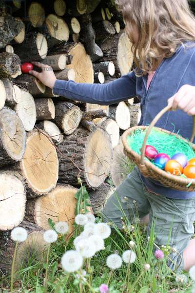 Girl looking for easter eggs. Saint-Gervais France