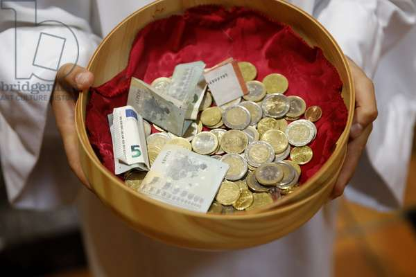 Collection During a Catholic Mass. Basket with Euros. Sallanches. France.