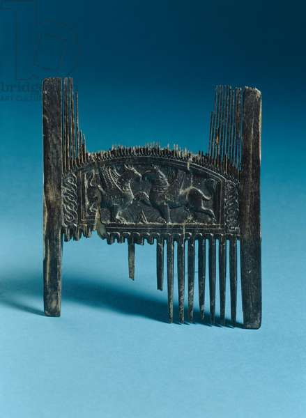 Double sided comb depicting two griffins (ivory)