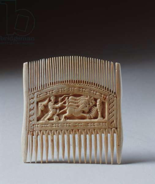 Double sided comb depicting a ploughing scene (ivory) (for other side see 282629)