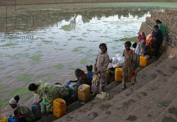 Children collecting water at