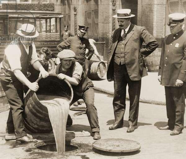 Policemen Pour Liquor Down a Sewer During Prohibition, 1921 (silver print photograph)
