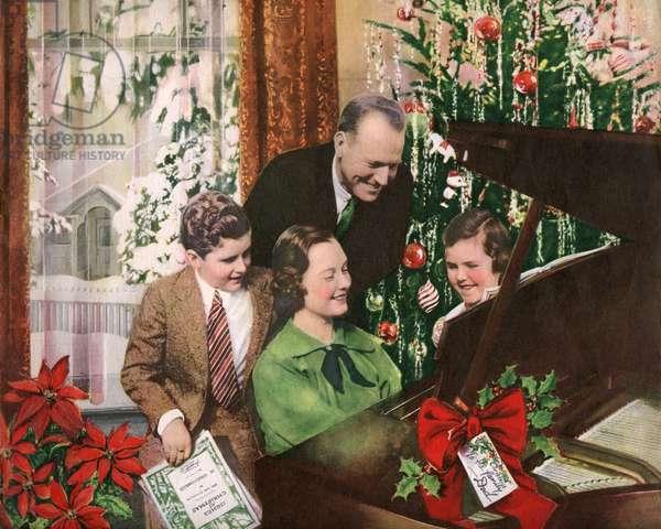 Family Singing Christmas Carols Around Piano, 1937 (hand-colored photo)
