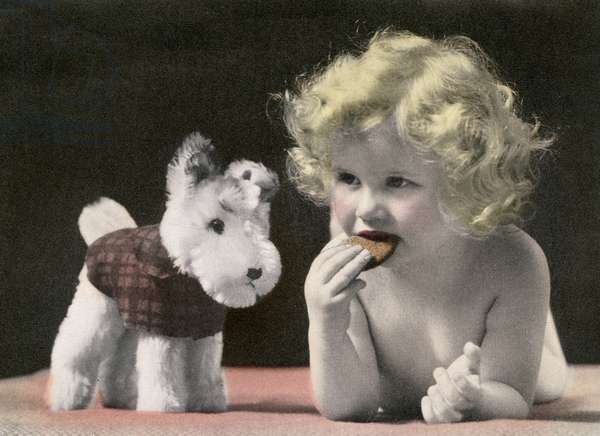 Child Eating a Cookie Next to Her Stuffed Dog Toy, 1933 (screen print)