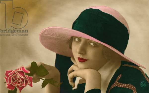 Flapper Wearing a Panama Cloche Hat Holding a Pink Rose, 1921 (colourised b/w photo)