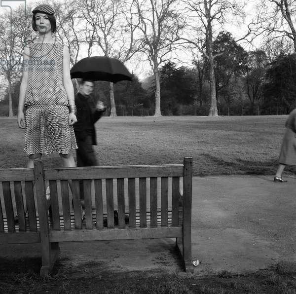 Derek Boshier and a model at a fashion shoot, Kensington Gardens, 1960 (b/w photo)