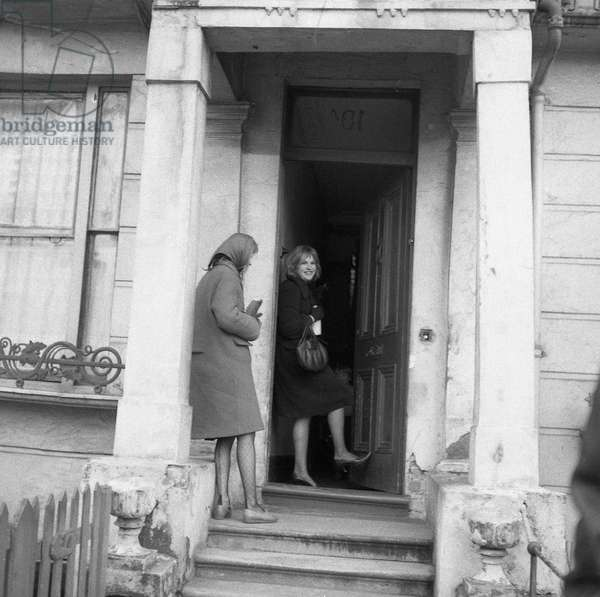 Anne Martin and Pauline Boty, Saturday afternoon, Winter, in and around Sutherland Place, Notting Hill, c.1960-61 (b/w photo)