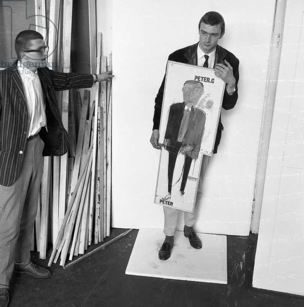 David Hockney with Peter Crutch holding Hockney's portrait of him, c.1960-61 (b/w photo)