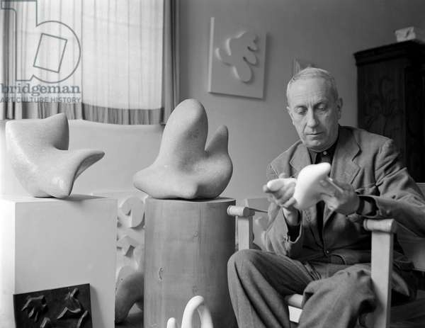 THE SULPTOR JEAN (Hans) ARP AT IS HOME IN PARIS - 1950