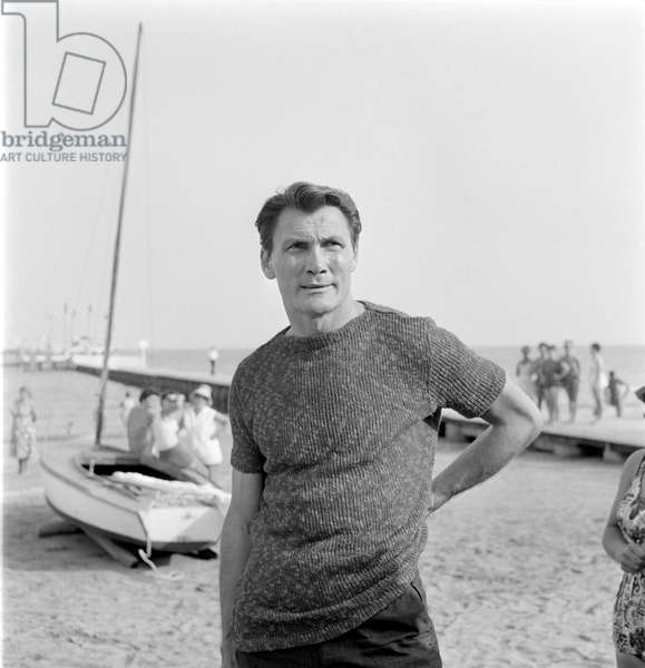 THE ACTOR JACK PALANCE ON VENICE LIDO BEACH AT INTERNATIONAL FILM FESTIVAL - 1962