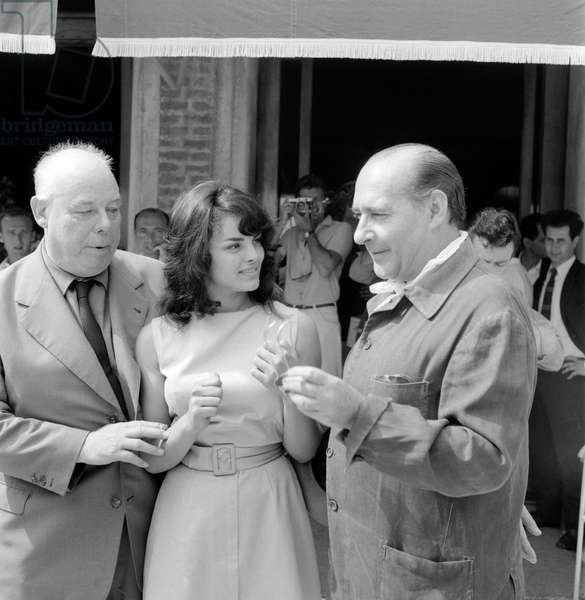 THE DIRECTORS JEAN RENOIR AND THE ACTRESS CATHERINE ROUVEL WITH ROBERTO ROSSELLINI AT INTERNATIONAL FILM FESTIVAL OF VENICE - 1959