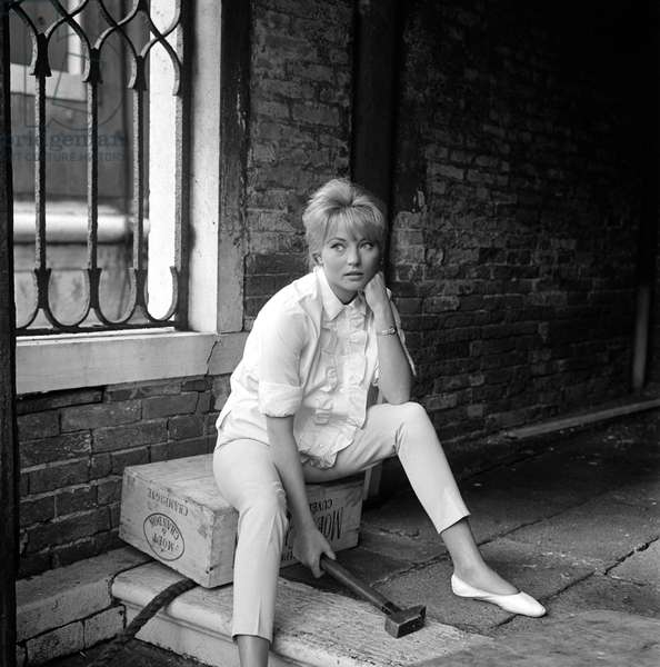 THE ACTRESS KARIN BAAL IN VENICE - 195? (sitting on a case of champagne Moet and candle, a hammer in hand, she wears privateers)
