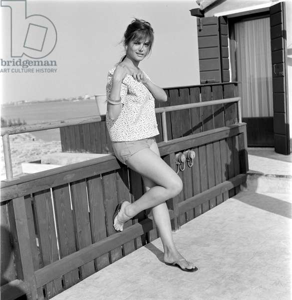 THE ACTRESS CLAUDIA CARDINALE (in shorts) AT INTERNATIONAL FILM FESTIVAL IN VENICE - 1958