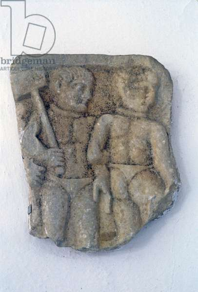 Relief fragment with rare Roman depiction of miners, or slaves, in work dress with hammer