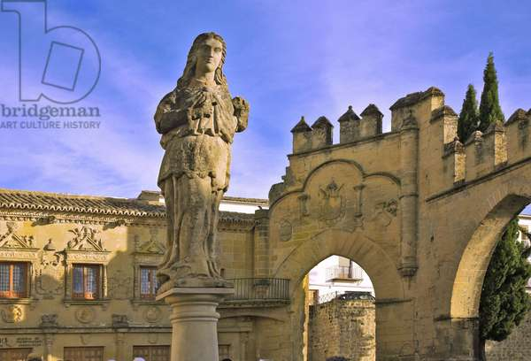 Spain - Andalusia - town of Baeza - Plaza del populo - Arch of Villalar and the Gate of Jaen - Roman statue representing Himilce, wife of Hannibal)