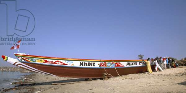 Senegal, launching a canoe in Mbour